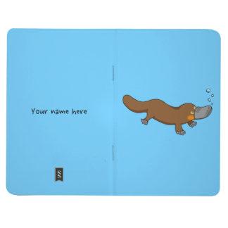 Platypus pato-cargado en cuenta dibujo animado cuadernos