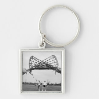 Play starts in a lacrosse team with the draw.Two Keychain