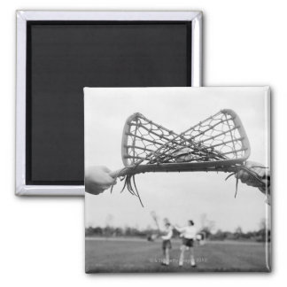 Play starts in a lacrosse team with the draw.Two Magnet