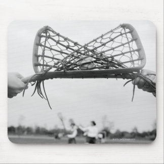Play starts in a lacrosse team with the draw.Two Mouse Pad