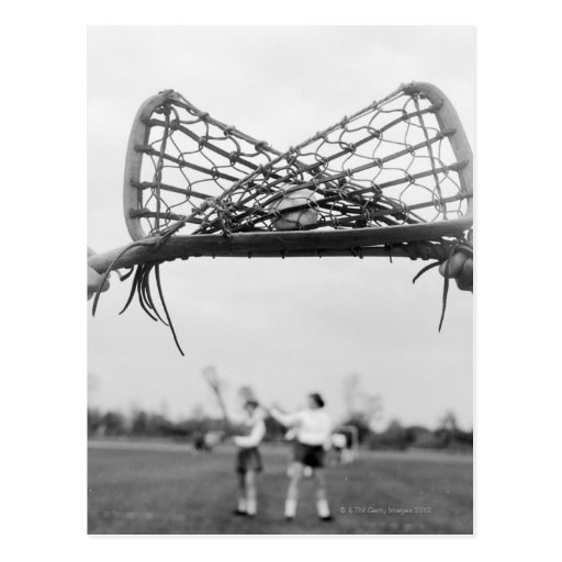 Play starts in a lacrosse team with the draw.Two Postcard