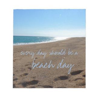 Playa con cita bloc de notas