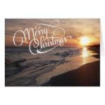 Playa de la puesta del sol con la tarjeta de