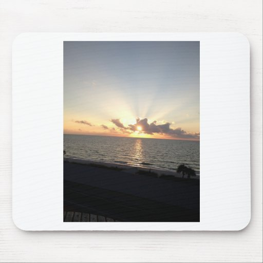 Playa de la puesta del sol tapete de ratones