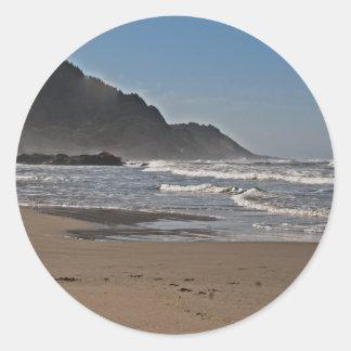 Playa de Neptuno, costa de Oregon Etiqueta Redonda