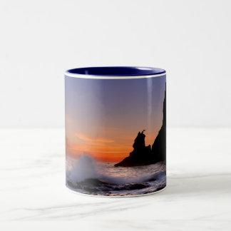 Playa de Rialto en la puesta del sol Taza
