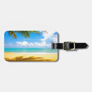 playa del paraíso de la palmera del arena de mar d etiquetas bolsa