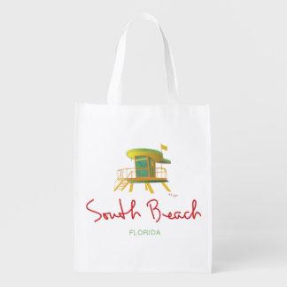 Playa del sur, estación del guardia de vida de la bolsas para la compra