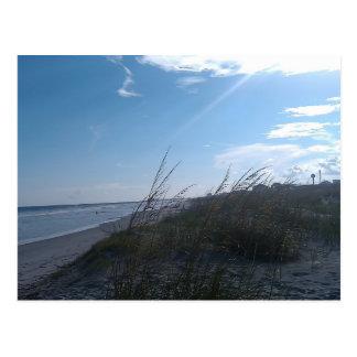 playa en la puesta del sol tarjetas postales