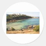 Playa ocultada etiqueta redonda