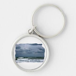 Playa tempestuosa con el texto de la imagen de las llaveros
