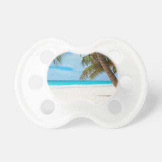 Playa tropical del paraíso chupete de bebe
