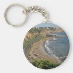 Playa verde de la costa en Lima-Perú Llaveros