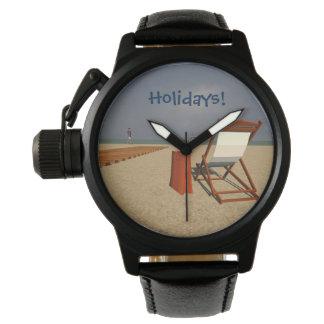 Playa y hamacas reloj de mano