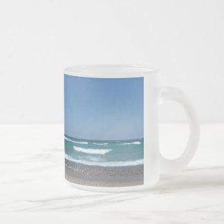 Playa y taza de las ondas
