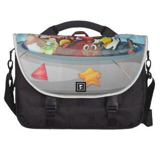 Playful animals inside the saucer commuter bags