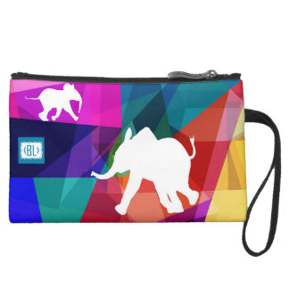 Playful baby elephant to leather bag for makeup