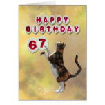 Playful cat and 67th Happy Birthday balloons Card