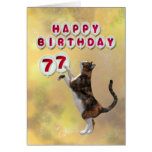 Playful cat and 77th Happy Birthday balloons Cards