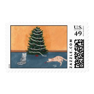Playful cats by the Christmas tree Postage Stamps