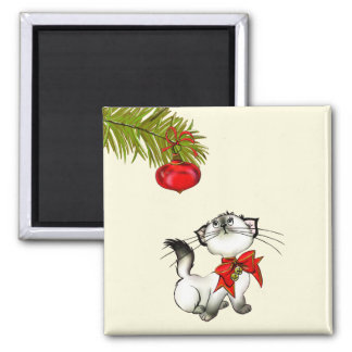 Playful Christmas Kitty With A Red Bow Magnet