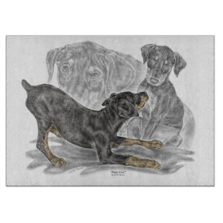Playful Doberman Pinscher Puppies Cutting Board