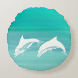 Playful dolphins in aquamarine ocean round pillow