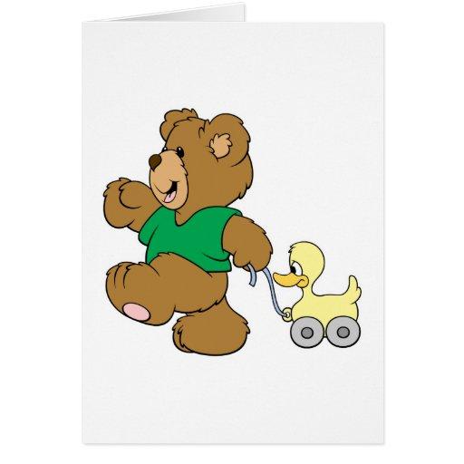 playful teddy bear with toy ducky card