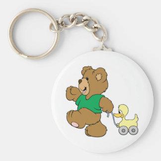 playful teddy bear with toy ducky keychain