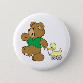 playful teddy bear with toy ducky pinback button