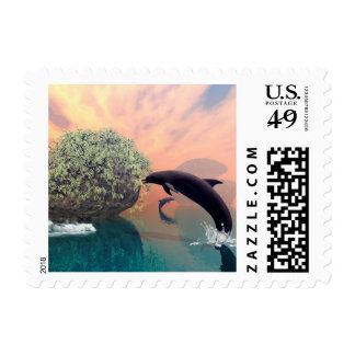 Playing and jumping dolphin in a fantasy landscape postage