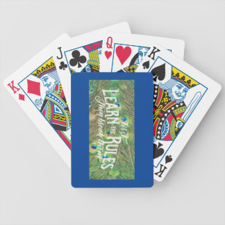 Playing cards with pic of peacock tail & saying