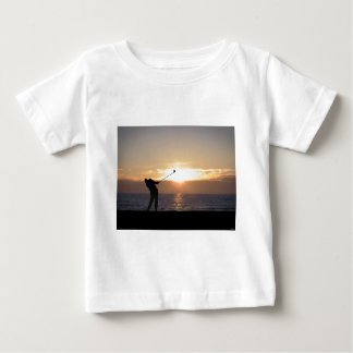 Playing Golf At Sunset Baby T-Shirt