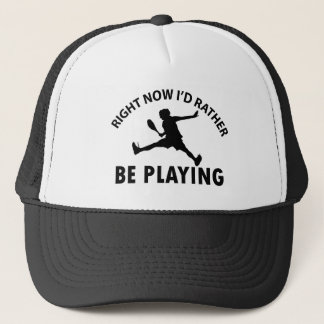 Playing  squash trucker hat