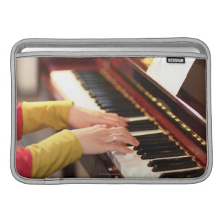 Playing the Piano MacBook Air Sleeves