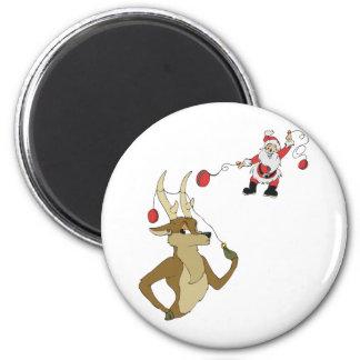 playing yo yo with Rain Deer Fridge Magnets