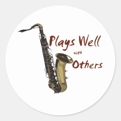 Plays Well Saxophone Classic Round Sticker