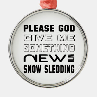 Please give me something new with Snow Sledding. Metal Ornament