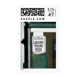 Please leash your dog sign postage