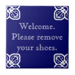 """Please remove shoes - Spanish White on Blue Tile<br><div class=""""desc"""">Spanish please remove shoes Tile.  Blue background. Customize colors.  Ask your guests to take off their shoes at your door.</div>"""