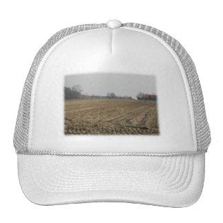 Plowed Field in Winter. Scenic. Hats