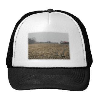 Plowed Field in Winter. Scenic. Hat