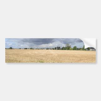 Plowed field under a stormy sky bumper sticker