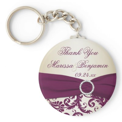 This plum and champagne damask wedding favor keychain has a faux ribbon and