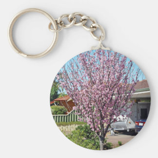 Plum tree in blossom with lavendar flowers keychain