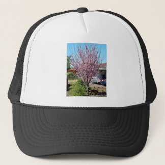 Plum tree in blossom with lavendar flowers trucker hat