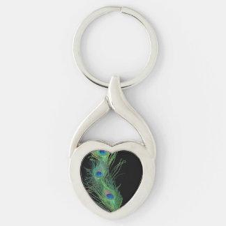 Pluma negra y verde del pavo real llavero plateado en forma de corazón