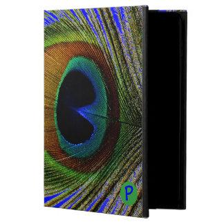 Pluma real del pavo real de la foto macra en el ai