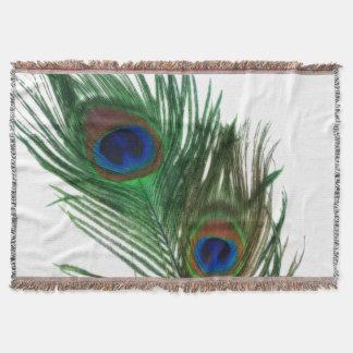 Plumas blancas preciosas del pavo real manta