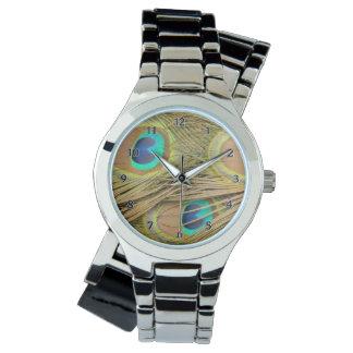 Plumas del pavo real reloj